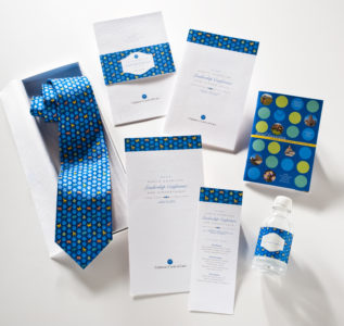 Circle of Care Leadership Conference cards necktie and bottle